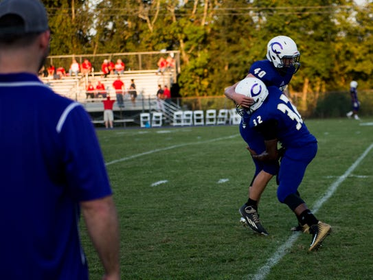 Seth Phillips (40) warms up before a game against Henry County.