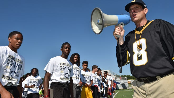 Jim Harbaugh leads the Pearl Pirate Football Camp at Pearl High School on Wednesday.