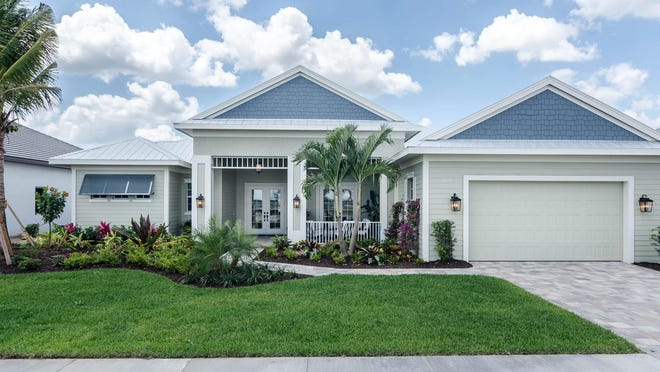 The 3,334-square-foot Key West by Florida Lifestyle Homes offers a formal dining room, an open great room, three bedrooms, three full baths, a powder room and pool bath.