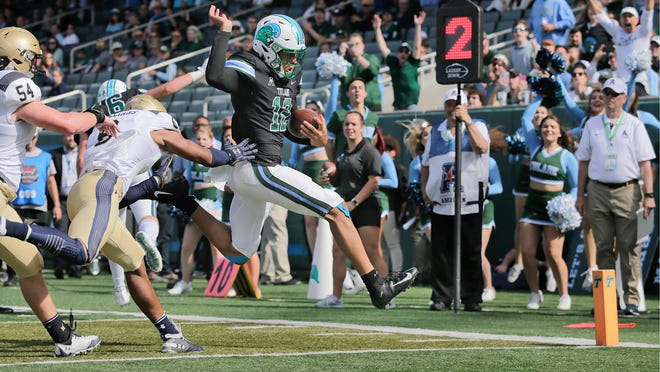 Tulane quarterback Justin McMillan (12) gets by Navy defenders for a touchdown during an NCAA college football game at Yulman Stadium in New Orleans, Saturday, Nov. 24, 2018. (David Grunfeld/The Times-Picayune via AP)