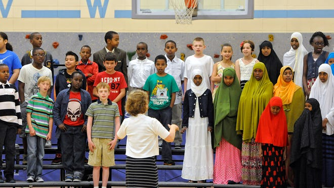 Talahi Community School fifth-grade students sing a song during their graduation ceremony Friday.