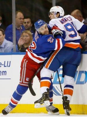 Dan Boyle and the Rangers will face John Tavares and the Islanders tonight.