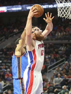 Pistons center Aron Baynes scores against Thunder center Enes Kanter during the second period Monday at the Palace.