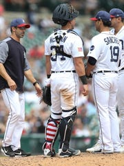 Tigers manager Brad Ausmus takes out pitcher Anibal