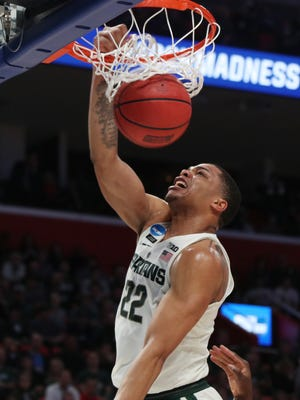 Michigan State's Miles Bridges dunks in the second half against Syracuse in the second round of the 2018 NCAA tournament at Little Caesars Arena in Detroit, Sunday, March 18.