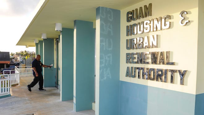 In this file photo, an investigator enters the Guam Housing and Urban Renewal Authority office building in Sinajana.