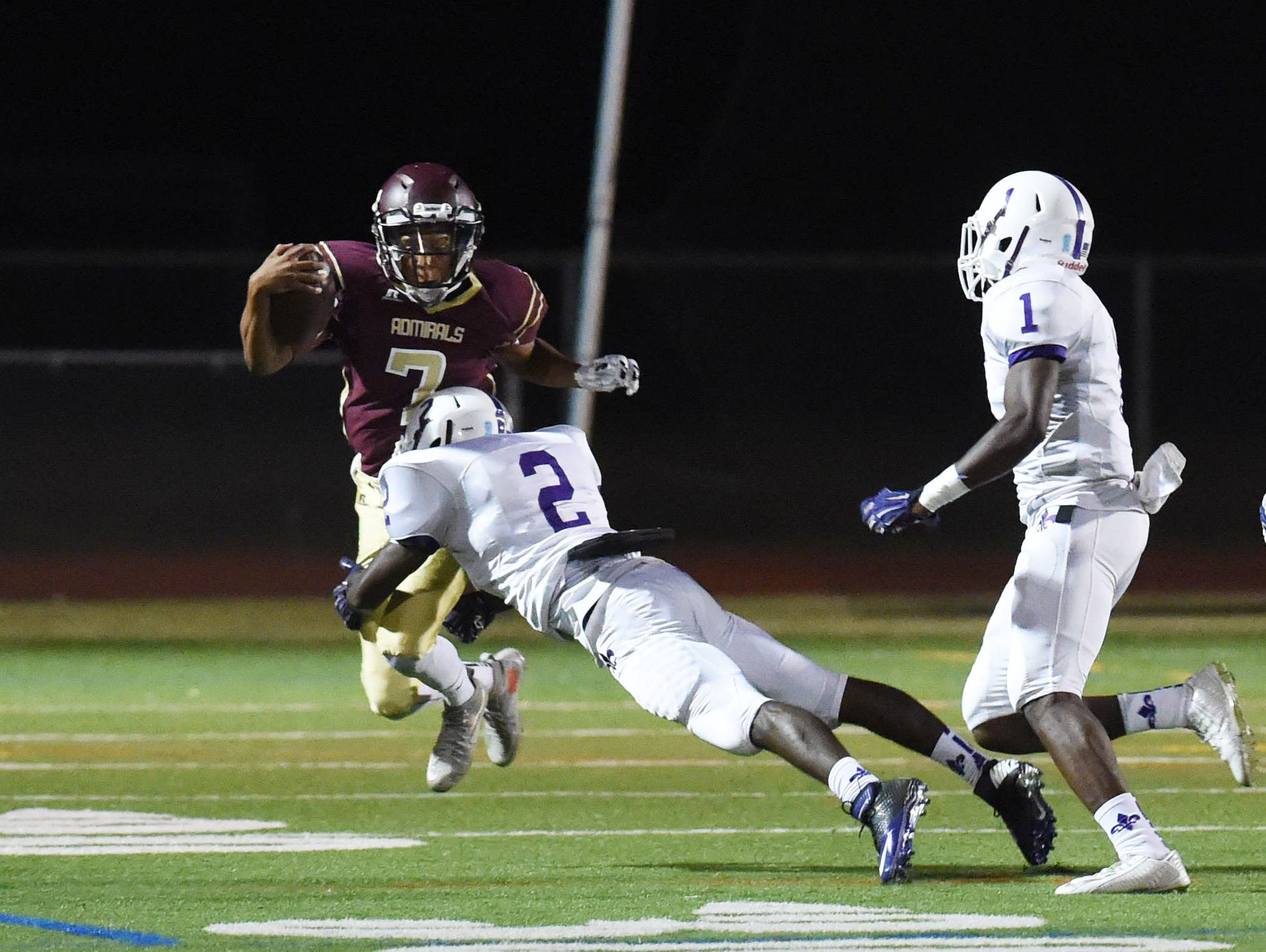 Arlington's Justin Leigh tries to jump out of the way of New Rochelle's Manny Walker during Friday's game.