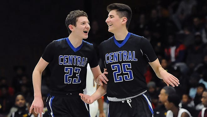 Brookfield Central players Cole Nau (left) and Andres Peralta-Werns celebrate a three-point shot made by Peralta-Werns.