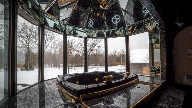 Graffiti mars the jetted tub that boxer Mike Tyson had installed with 180-degree views of his 58-acre property.