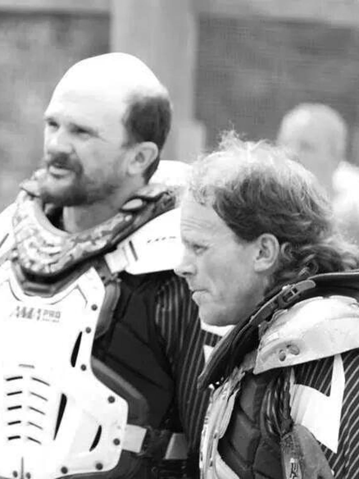 Todd Libhart (left) and Phil Libhart watch other riders