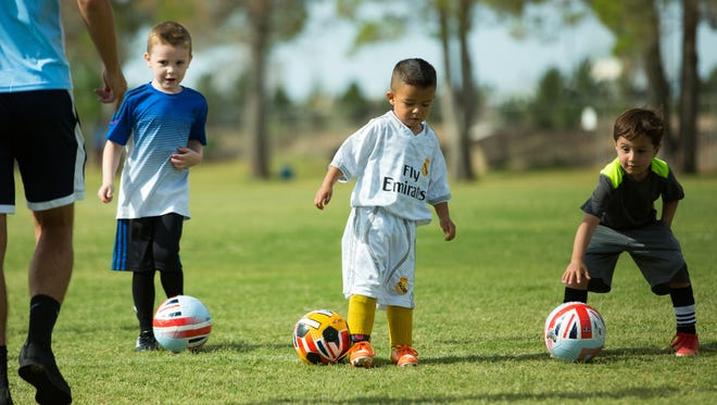 Challenger Sports British Soccer Camp participants pictured from left to right, Sparky Jr. Edwards, 5, Adriel Ornelas, 4, and Ephrem Settles, 5, prepare to take off from the starting line during a soccer drill on Friday. About 190 kids participated during the week long camp that included instruction from Great Britain and Brazil.