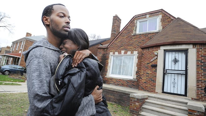 Kiana Johnson, mother of Chanell Berry, 7, hugs her brother, Chanell's uncle Dominique Johnson outside of the home where shooting occurred.