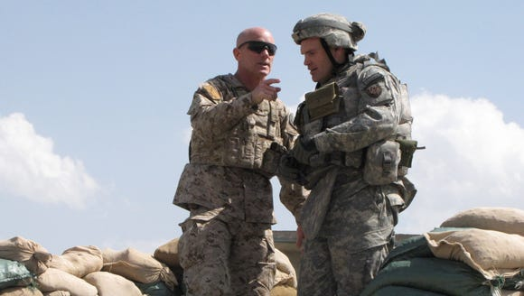 Robert Harward is pictured at left in Afghanistan in