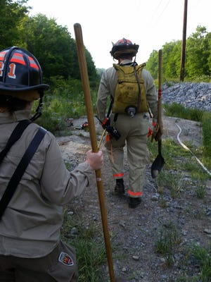 Crews respond to a brush fire Monday evening near Vermont 289 and Vermont 15 in Essex.