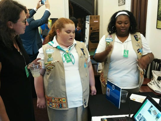 Newark-area Girl Scouts Sarah Metcalf, center, and