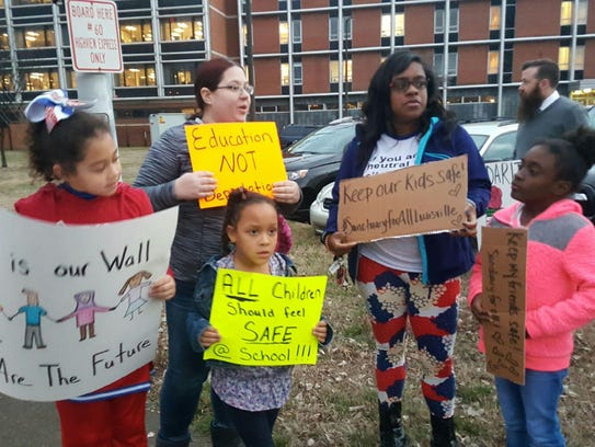 Protesters gather before Tuesday night's Jefferson