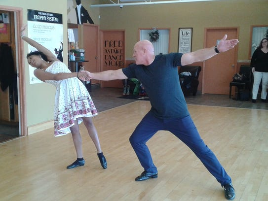 Teacher Janique Sanders and Mike Kulka work on moves