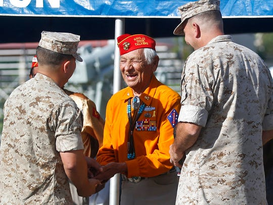 In this Sept. 28, 2015, file photo, former United States Marine and Navajo Code Talker Roy Hawthorne Sr. (center) talks with Marines including Major Gen. Daniel O'Donohue (right) at a ceremony honoring the code talkers at Camp Pendleton, California.