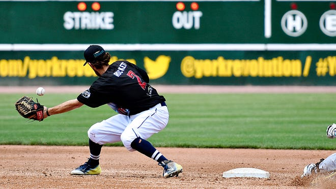 York Revolution's Michael Rockett, left, took the mound for the Revs on Wednesday night to close out the team's 13-2 loss to the Somerset Patriots. That was seventh different position he's played for the team this year. Dawn J. Sagert photo