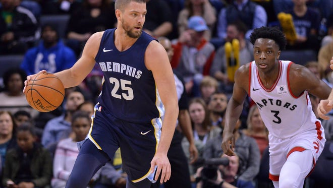 Memphis Grizzlies forward Chandler Parsons (25) controls the ball against Toronto Raptors forward OG Anunoby (3) in the first half of an NBA basketball game Friday, Dec. 8, 2017, in Memphis, Tenn. (AP Photo/Brandon Dill)