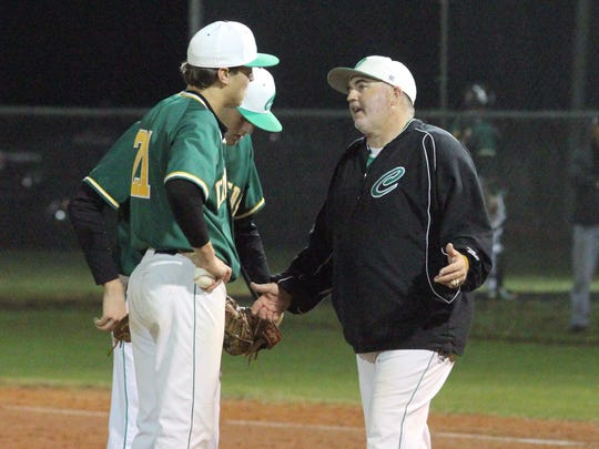 Catholic's Sonny Reedy makes a mound visit with Steve Halstead in the 4th.