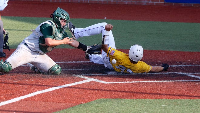 Byrd's Lucas Henderson slides in safely to score the game-tying run in the Yellow Jackets' 2-1 semifinal win over Louisiana.