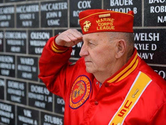 Herb Gilmour of the Marine Corps League Detachment 688, salutes during the Veterans Day ceremony on Wednesday morning at the Montana Veterans Memorial.