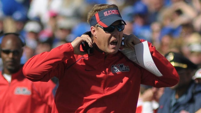 Ole Miss dropped Sunday in the major college football polls following its 37-24 loss to Memphis on Saturday.