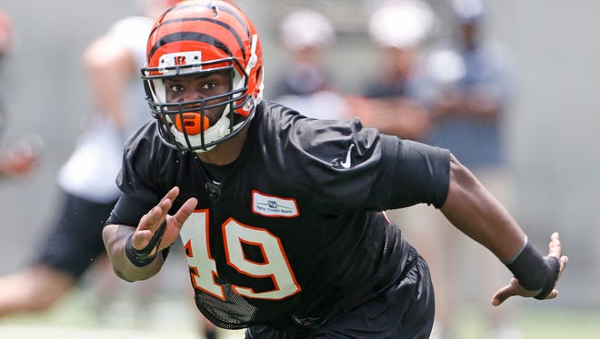 Bengals linebacker Brandon Joiner, works in a drill during mini-camp held at Paul Brown Stadium Tuesday June 10, 2014.
