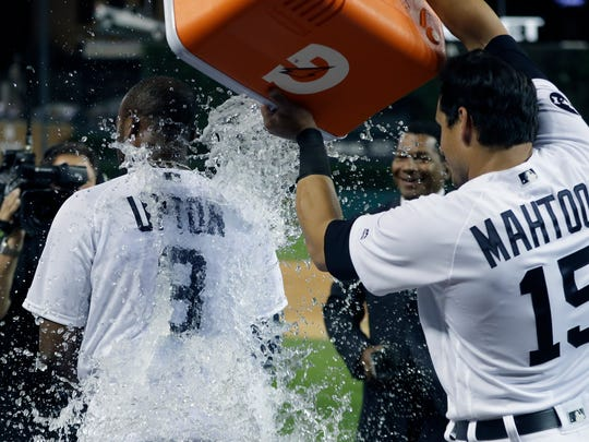 Tigers leftfielder Justin Upton is doused by teammate Mikie Mahtook after hitting a two-run walk-off home run during the ninth inning of the Tigers' 12-11 win over the Twins on Saturday, Aug. 12, 2017, at Comerica Park.