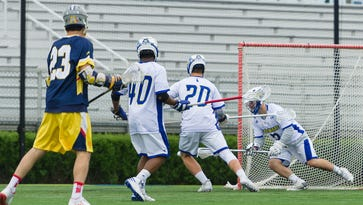Paul Major (#27) passes the ball in the first quarter of UD vs Drexel men's lacrosse at Delaware Stadium on Saturday.