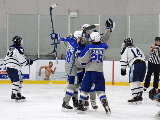 It's another goal celebration for the Salem Rocks, this one including Anthony Gattoni (18) and Martino Zaia (25).