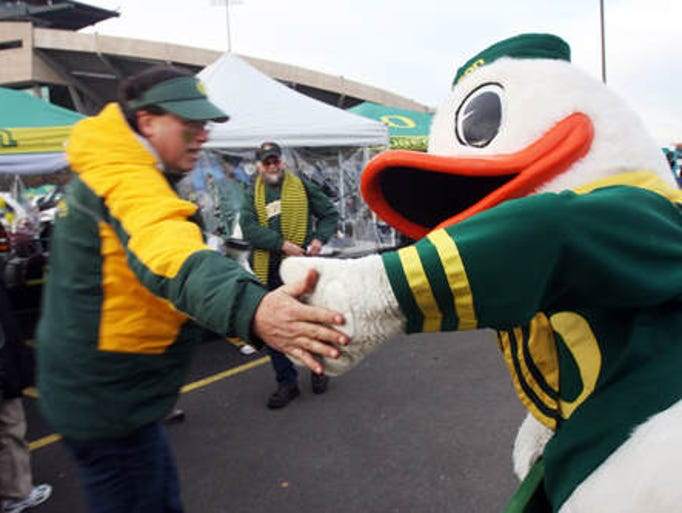 The Oregon Duck greets supporters and enemies outside Autzen Stadium in Eugene before the Civil War football game on Thursday, Dec. 3, 2009.