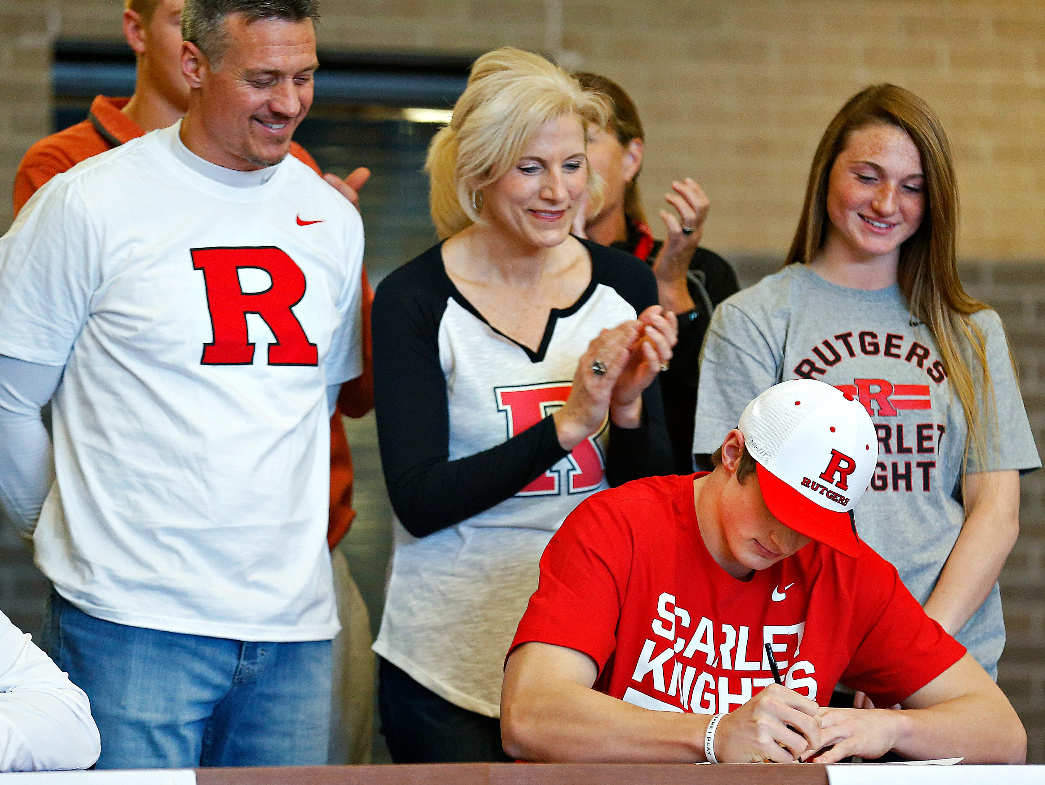 Travis Vokolek signs a national letter of intent to Rutgers University during a National Signing Day ceremony held at Kickapoo High School in Springfield, Mo. on Feb. 1, 2017.