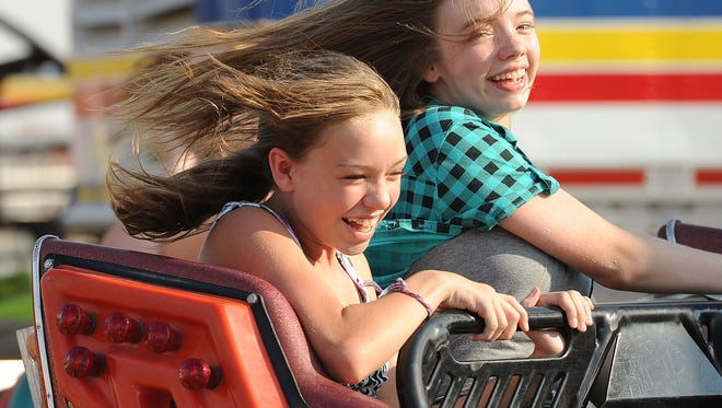 Girls enjoy a ride on the Scrambler at the Johnson County Fair in 2012.