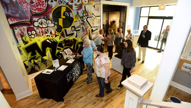 """Crowds visit the Pensacola Museum of Art for the """"Between the Layers"""" exhibit by Rachael Pongetti during gallery night on April 17."""