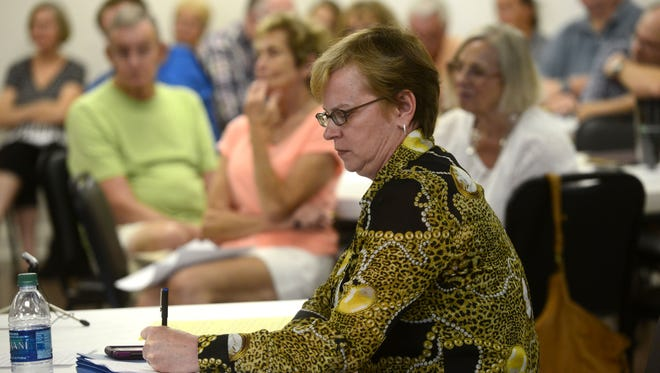 Vikki Garrett, with the West Florida Regional Planning Council, takes notes during an open forum at Pensacola Beach Community Church to get input on what services should be provided by the Santa Rosa Island Authority and how they should be funded.