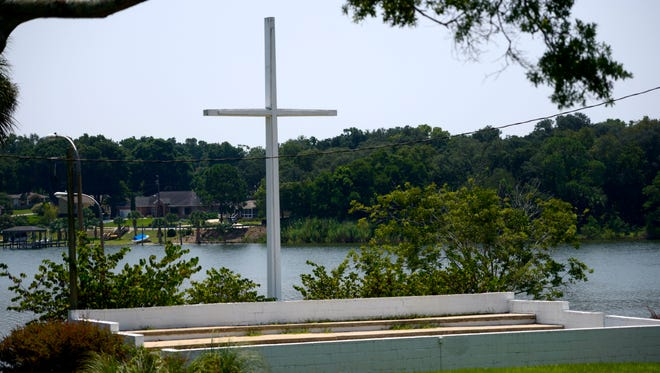A Washington, D.C., advocacy group is calling for the removal of the large cross at Bayview Park and threatening legal action if the city does not comply.