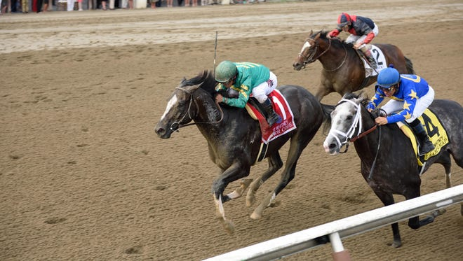 Honor Code (#1) ran down front-running Liam's Map (#4)  to win Saratoga's $1.25 million Whitney Stakes Saturday, with Tonalist third.
