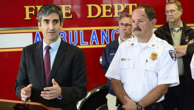 Burlington Mayor Miro Weinberger, left, and Fire Chief Seth Lasker announce a partnership with UVM Medical Center to bring more paramedics to the department.