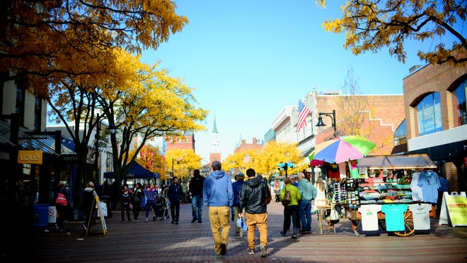 Diners and shoppers walk north on Church Street on Nov. 7.