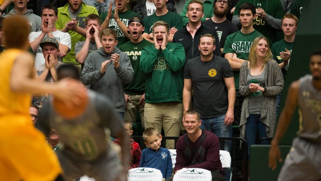 CSU fans cheer on the Rams during a Thursday night game against Long Beach State at Moby Arena. CSU hosts the University of Colorado on Sunday.