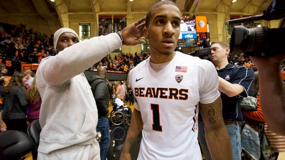 Jan 9, 2016; Corvallis, OR, USA; Oregon State  guard Gary Payton II (1) celebrates with his father and former NBA star Gary Payton after the game against the California Golden Bears at Gill Coliseum. The Beavers won 77-71.