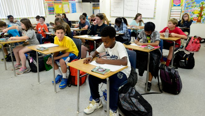 Seventh graders work on their study guides ahead of mid-term at the Beulah Academy of Science. Beulah is one of six charter schools in the Escambia County School District.