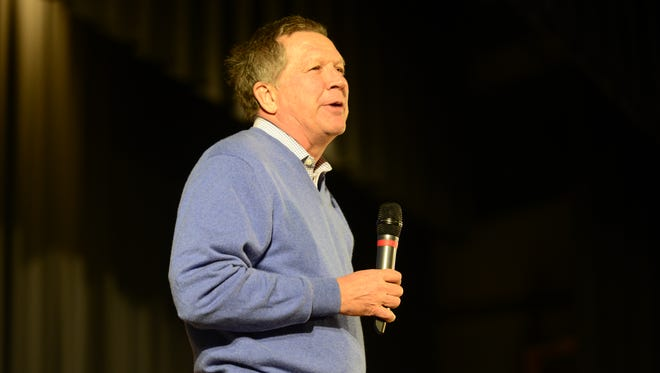 Republican presidential candidate and Ohio Gov. John Kasich speaks to a full auditorium at Colchester High School on Saturday.