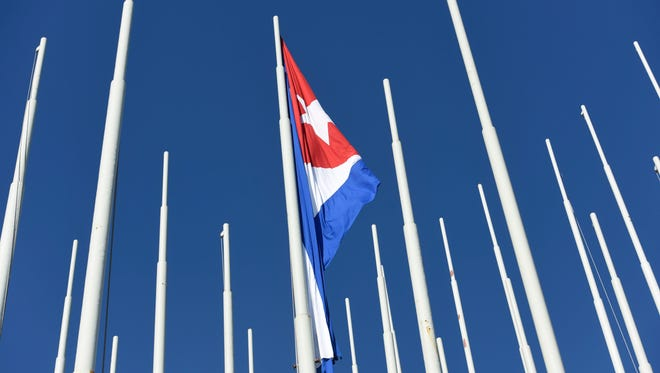 """The Cuban flag flies in the el monte de las Banderas """"mountains of flags"""" monument directly in front of the U.S. Embassy in Havana, Cuba, in August 2015."""