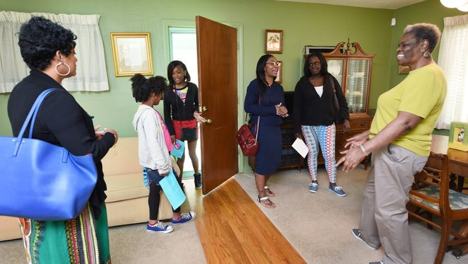 Guide Minnie Watson, right, talks with a group of visitors from Miami at Medgar Evers home in Jackson on Thursday.