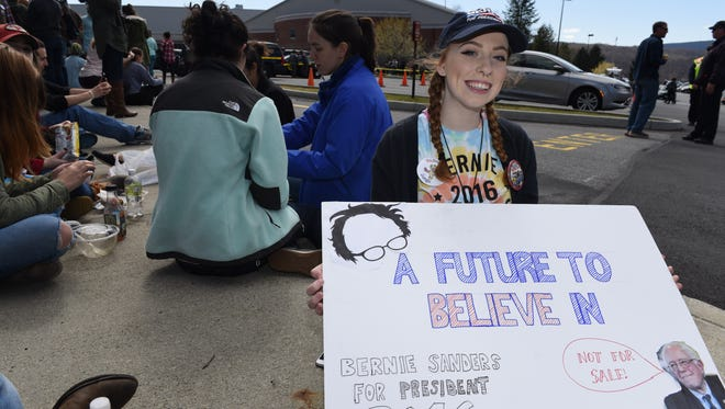 Dutchess Community College student, Taylor MacArdle, from Pleasant Valley shows her sign while waiting of the Bernie Sanders rally at Marist College to begin on Tuesday.