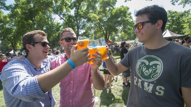 Ryan Bernard, Matt Perrine and Matt Genet toast at a beer festival. Fort Collins' 20th craft brewery will debut Saturday at the Fort Love Brewers Jamboree.