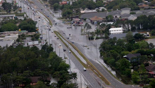 In this 2014 photo, areas of Gulf Breeze remain underwater two days after severe storms in the area. Stormwater drainage is among the infrastructure concerns for Santa Rosa County.